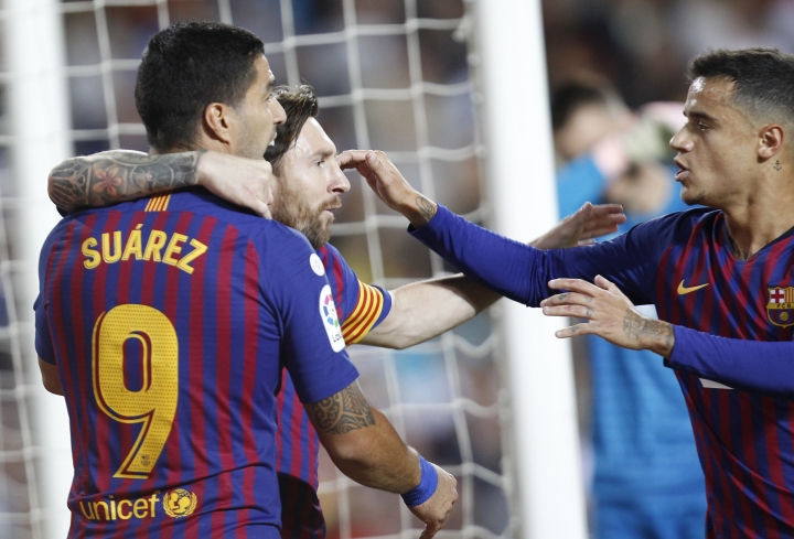 Barcelona forward Lionel Messi, center, celebrates after scoring against Valencia during the Spanish La Liga soccer match between Valencia and Barcelona, at the Mestalla stadium in Valencia, Spain, Sunday, Oct. 7, 2018. (AP Photo/Alberto Saiz)