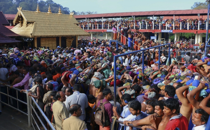 FILE - In this Dec. 1, 2015 file photo, Hindu worshippers stand in queues outside the Sabarimala temple, one of the world's largest Hindu pilgrimage sites, in the southern Indian state of Kerala. India's ruling party and the main opposition are both supporting a protest to keep females of menstruating age from entering the temple, in what some political observers say is a bid to shore up votes ahead of next year's general election. The country's Supreme Court had on Sept. 28, 2018, lifted the temple's ban on women of menstruating age, holding that equality is supreme irrespective of age and gender. (AP Photo/ Hareesh Kumar A S, File)