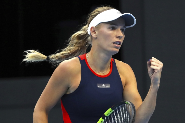 Caroline Wozniacki of Denmark reacts while competing against Anastasija Sevastova of Latvia in the women's singles final in the China Open at the National Tennis Center in Beijing, Sunday, Oct. 7, 2018. (AP Photo/Mark Schiefelbein)