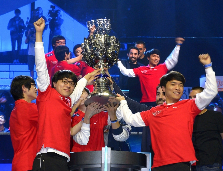 FILE - In this Oct. 4, 2013, file photo, members of Korea's SK Telecom T1 team celebrate with their trophy after defeating China's Royal Club at the League of Legends Season 3 World Championship Final, in Los Angeles. Die-hard esports fans are gathering by the thousands in South Korea this month to watch the world's top League of Legends players show off their skill and expertise.In the United States, the game's publisher is hoping to draw a more casual crowd by starting with an important question: What is League of Legends? (AP Photo/Mark J. Terrill,File)