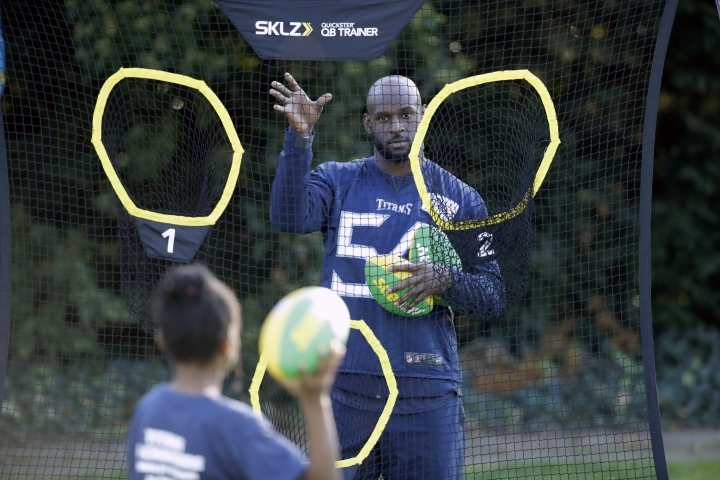 Tennessee Titans' linebacker Rashaan Evans takes part in an NFL flag event with local school children after an NFL training session at Syon House, in Syon Park, south west London, Friday, Oct. 19, 2018. The Tennessee Titans are preparing for an NFL regular season game against the Los Angeles Chargers in London on Sunday. (AP Photo/Matt Dunham)