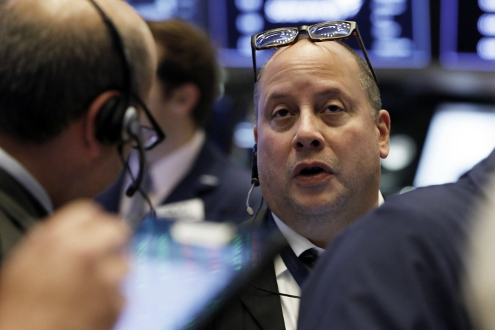 Trader Jeffrey Vazquez works on the floor of the New York Stock Exchange, Friday, Oct. 19, 2018. Strong earnings are sending U.S. stocks higher Friday at the end of a choppy week of trading. (AP Photo/Richard Drew)