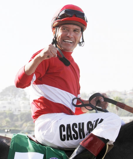 FILE - In this Aug. 28, 2011, file photo, jockey Patrick Valenzuela, sitting aboard Acclamation, celebrates victory in the $1 million Pacific Classic horse race at Del Mar Thoroughbred Club in Del Mar, Calif. Valenzuela has pleaded guilty to misdemeanor domestic violence for slapping his girlfriend at a Southern California restaurant. The San Diego Union-Tribune reported Friday, Oct. 19, 2018, that the seven-time Breeders Cup winner entered the plea earlier this week, was fined nearly $900 and ordered to take domestic violence recovery classes. (AP Photo/Lenny Ignelzi, File)