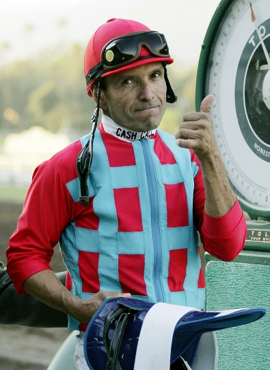 FILE - In this Oct. 28, 2006, file photo, jockey Patrick Valenzuela reacts after riding Romance Is Diane to victory in the California Cup Juvenile Fillies horse race at Santa Anita Park in Arcadia, Calif. Valenzuela has pleaded guilty to misdemeanor domestic violence for slapping his girlfriend at a Southern California restaurant. The San Diego Union-Tribune reported Friday, Oct. 19, 2018, that the seven-time Breeders Cup winner entered the plea earlier this week, was fined nearly $900 and ordered to take domestic violence recovery classes. (AP Photo/Chris Carlson, File)