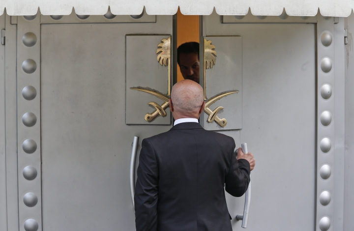 A man enters Saudi Arabia's consulate in Istanbul, Friday, Oct. 19, 2018. A Turkish official said Friday that investigators are looking into the possibility that the remains of missing Saudi journalist Jamal Khashoggi may have been taken to a forest in the outskirts of Istanbul or to another city — if and after he was killed inside the consulate earlier this month. (AP Photo/Lefteris Pitarakis)