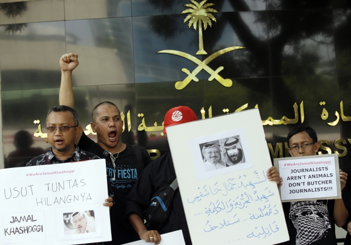 A dozen of Indonesian journalists hold posters with photos of Saudi writer Jamal Khashoggi during a protest outside Saudi Arabian Embassy in Jakarta, Indonesia, Friday, Oct. 19, 2018. A Turkish official said Friday that investigators are looking into the possibility that the remains of missing Saudi journalist Jamal Khashoggi may have been taken to a forest in the outskirts of Istanbul or to another city, if and after he was killed inside the Saudi Consulate in Istanbul earlier this month. (AP Photo/Achmad Ibrahim)