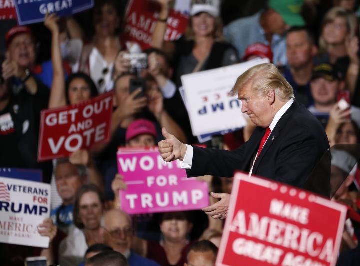 President Donald Trump speaks at a campaign rally Friday, Oct. 19, 2018, in Mesa, Ariz. Trump is in Arizona stumping for Senate candidate Martha McSally. (AP Photo/Matt York)