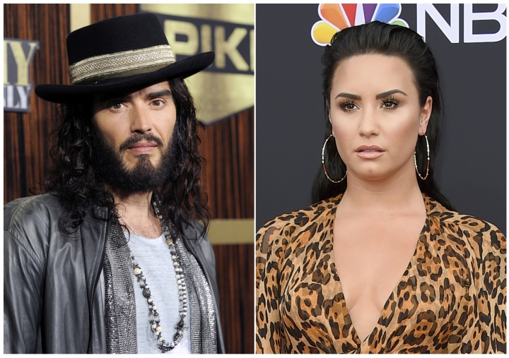 """This combination photo shows Russell Brand at """"Eddie Murphy: One Night Only,"""" a celebration of Murphy's career in Beverly Hills, Calif., on Nov. 3, 2012, left, and singer Demi Lovato at the Billboard Music Awards in Las Vegas on May 20, 2018. Celebrities are now owning the struggle and their roads to recovery. Brand wrote a book about addiction, """"Recovery: Freedom from Our Addictions,"""" calling this the age of addiction an epidemic. Lovato took to Instagram with a health update not long after her recent overdose: """"I have always been transparent about my journey with addiction. What I've learned is that this illness is not something that disappears or fades with time. It is something I must continue to overcome and have not done yet."""" (AP Photo)"""