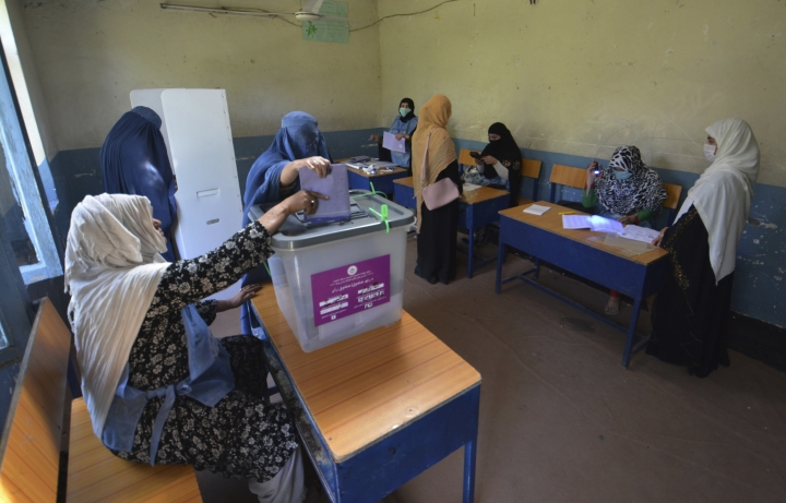 Women cast their votes in a pooling station in Jalalabad, capital of eastern Nangarhar province, Afghanistan, Saturday, Oct. 20, 2018. Tens of thousands of Afghan forces fanned out across the country to provide security, as voting began Saturday in the elections that followed a campaign marred by relentless violence. (AP Photo/Mohammad Anwar Danishyar)