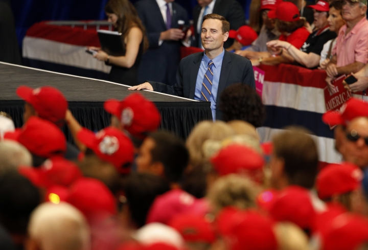 In this Sept. 20, 2018, photo, Nevada state Attorney General Adam Laxalt waits to take the stage before a campaign rally with President Donald Trump in Las Vegas. In the Nevada Governor's race, Laxalt has frequently included anti-California messages in campaign appearances and statements.(AP Photo/John Locher)