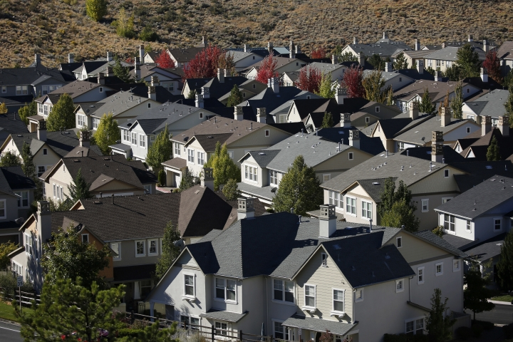 In this Oct. 12, 2018, photo, homes fill a small valley in Reno, Nev. A population inrush to Nevada has been driven by people seeking more affordable housing and a growing tech industry around Reno. (AP Photo/John Locher)