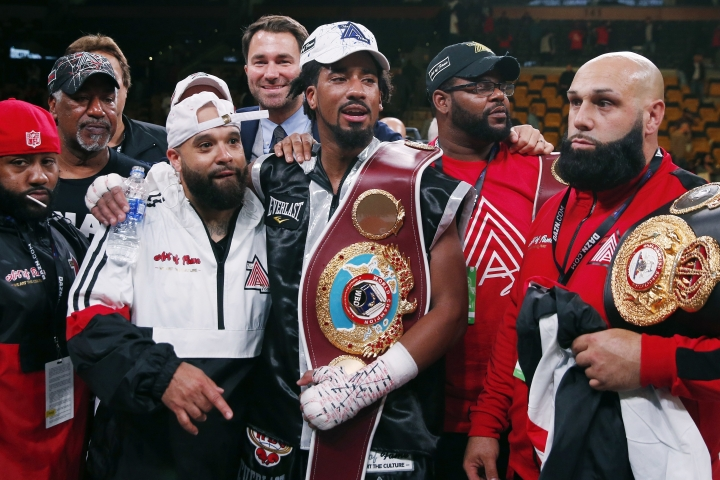 Demetrius Andrade, center, stands with members of his team after defeating Walter Kautondokwa in a WBO middleweight championship boxing match in Boston, Sunday, Oct. 21, 2018. (AP Photo/Michael Dwyer)