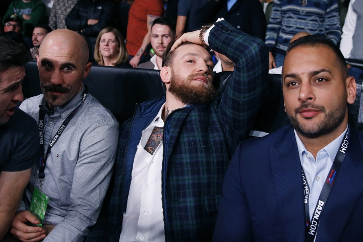 UFC champion Conor McGregor sits ringside before the boxing match between Demetrius Andrade and Walter Kautondokwa in Boston, Saturday, Oct. 20, 2018. (AP Photo/Michael Dwyer)