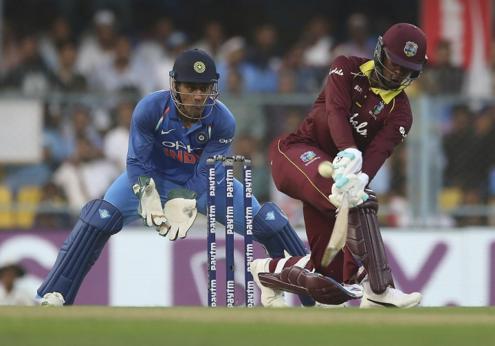 West Indies' batsman Shimron Hetmyer, right, attempts to play a shot before being dismissed during the first one-day international cricket match between India and West Indies in Gauhati, India, Sunday, Oct. 21, 2018. (AP Photo/Anupam Nath)