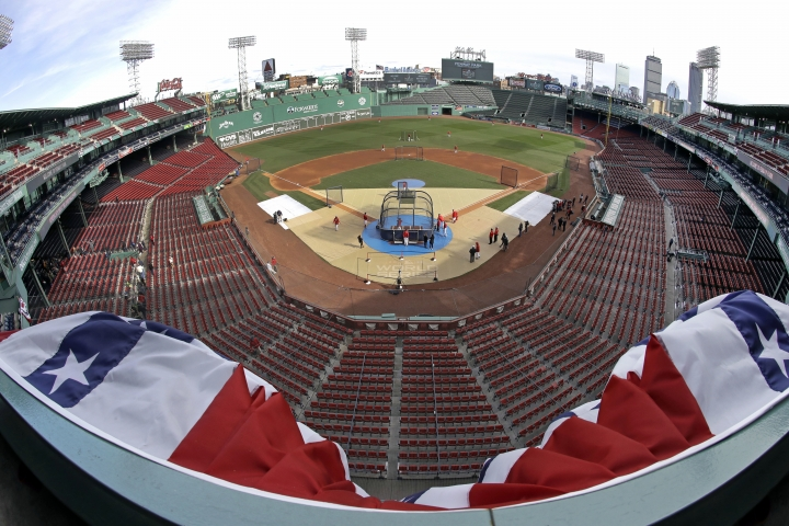 Bunting billows up in the wind at Fenway Park's upper deck as Boston Red Sox players work out, Sunday, Oct. 21, 2018, in Boston. The Red Sox are preparing for Game 1 of the baseball World Series against the Los Angeles Dodgers scheduled for Tuesday in Boston. (AP Photo/Elise Amendola)