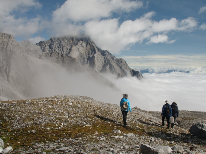 This Sept. 21, 2018 photo shows a Chinese Academy of Sciences research team atop the Jade Dragon Snow Mountain in the southern province of Yunnan in China. They are part of ongoing efforts to track the melting of the mountain's Baishui Glacier No.1 which has lost 60 percent of its mass and shrunk 250 meters since 1982. (AP Photo/Sam McNeil)