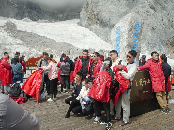 This Sept. 22, 2018 photo shows tourists visiting the Baishui Glacier No.1 atop of the Jade Dragon Snow Mountain in the southern province of Yunnan in China. Scientists say the glacier is one of the fastest melting glaciers in the world due to climate change and its relative proximity to the Equator. It has lost 60 percent of its mass and shrunk 250 meters since 1982. (AP Photo/Sam McNeil)