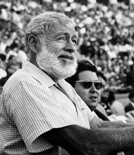 "FILE - In this Nov. 1960 file photo, U.S. novelist Ernest Hemingway attends a bullfight in Madrid, Spain. Two Ernest Hemingway stories written in the mid-1950s and rarely seen since will be published next year. The director of Hemingway's literary estate, Michael Katakis, told The Associated Press recently that ""The Monument"" and ""Indian Country and the White Army"" will be included with a reissue of the author's classic ""For Whom the Bell Tolls."" (AP Photo/File)"