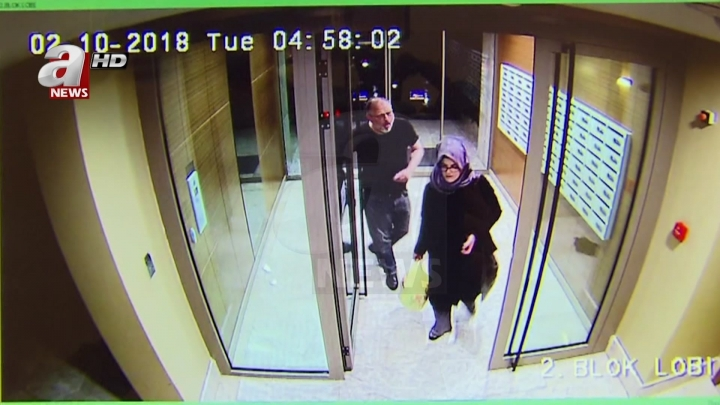 In this image taken from CCTV video that emerged Monday Oct. 22, 2018, purportedly showing Saudi writer Jamal Khashoggi and his fiancee, Hatice Cengiz, at an apartment building in Istanbul, Turkey, just hours before his death in the Saudi Arabian Consulate. The video was broadcast by the pro-Turkish government Turkish television channel A News, and was said to be obtained via Turkey's security sources. (A News via AP) MANDATORY CREDIT - DO NOT OBSCURE LOGO