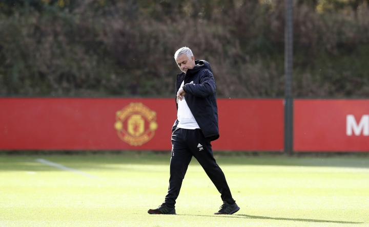 Manchester United manager Jose Mourinho looks at his watch, during a training session at the Aon Training Complex, in Manchester, England, Monday, Oct. 22, 2018. Manchester United will play Juventus in a group stage Group H Champions League soccer match on Tuesday. (Martin Rickett/PA via AP)