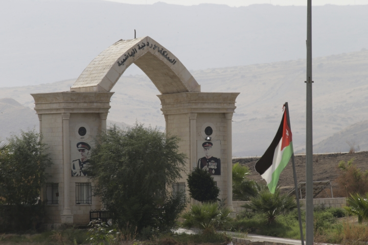 A Jordanian flag flies on a bridge leading from Israel to Jordan, in the Jordan valley area called Baqura, Jordanian territory that was leased to Israel under the 1994 peace agreement between the two countries, Monday, Oct. 22, 2018. Jordan's King Abdullah II on Sunday said he has decided not to renew the lease on two small areas of Baqura and Ghamr, that was part of his country's landmark peace treaty with Israel. The leases expire next year after 25 years. (AP Photo/Ariel Schalit)