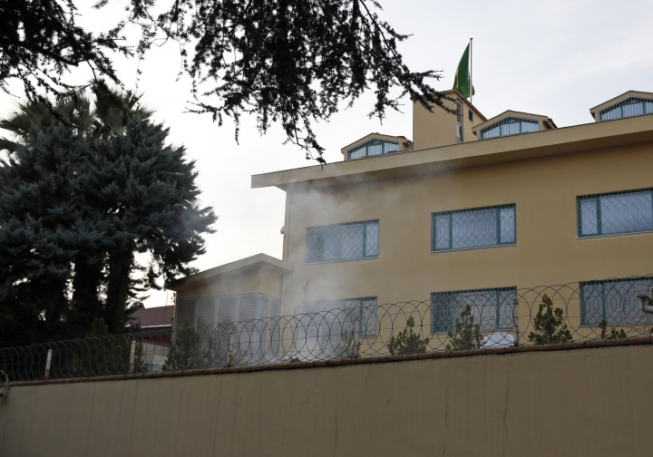"""In this photo taken on Wednesday, Oct. 3, 2018, white smoke billows from the courtyard of Saudi Arabia's consulate in Istanbul. A video shared by a television channel that is close to Turkey's government broadcasted on Monday, Oct. 22, 2018 appears to show three men burning documents at the Saudi Consulate's backyard a day after Saudi writer Jamal Khashoggi was killed. A Haber news channel said the surveillance camera video - allegedly showing """"evidence"""" being burned inside a drum - was recorded on Oct. 3. (AP Photo/Lefteris Pitarakis)"""