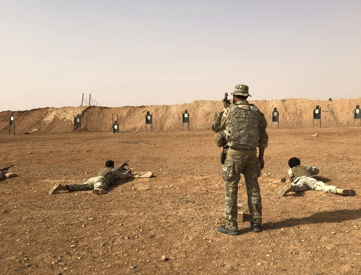 Members of the Maghawir al-Thawra Syrian opposition group receive firearms training from U.S. Army Special Forces soldiers at the al-Tanf military outpost in southern Syria on Monday, Oct. 22, 2018. (AP Photo/Lolita Baldor)