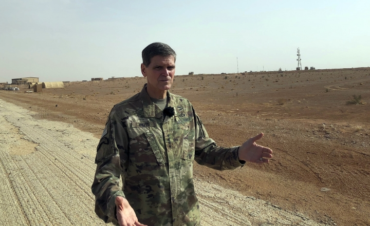 US Gen. Joseph Votel, top U.S. commander in the Middle East, speaks to reporters during an unannounced visit Monday, Oct. 22, 2018, to the al-Tanf military outpost in southern Syria. The U.S. trains Syrian opposition forces at the outpost. (AP Photo/Lolita Baldor)