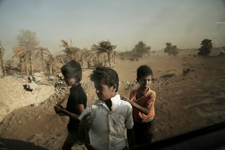 FILE - In this Feb. 12, 2018 file photo, homeless children stand on the road in Hodeida, Yemen. The United Nations children's agency said Friday, Oct. 19, 2018 that Yemen's economic crisis and the relentless violence at a key Red Sea port city risks leaving millions of children and families without food, clean water and sanitation. (AP Photo/Nariman El-Mofty, File)