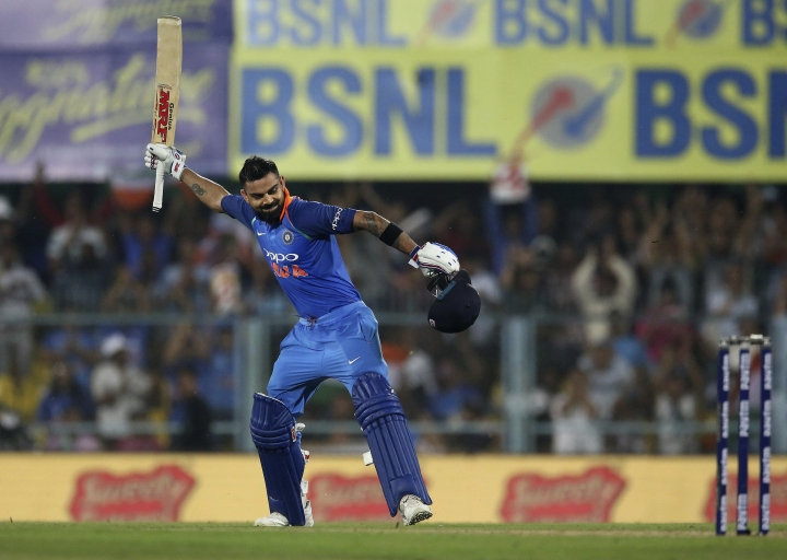 India's captain Virat Kohli celebrates after scoring a century during the first one-day international cricket match between India and West Indies in Gauhati, India, Sunday, Oct. 21, 2018. (AP Photo/Anupam Nath)
