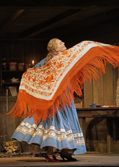 "This Sept. 28, 2018 photo released by the Metropolitan Opera shows soprano Eva-Maria Westbroek as the saloon keeper heroine Minnie in a scene from Puccini's ""La Fanciulla del West"" at the Metropolitan Opera in New York. The opera will be broadcast to movie theaters live in HD on Oct. 27. (Ken Howard/Metropolitan Opera via AP)"