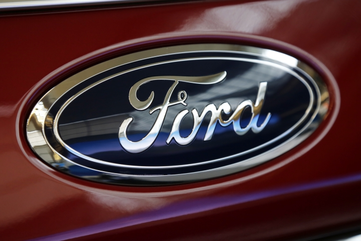 FILE- This Feb. 15, 2018, photo shows a Ford logo on a 2018 Expedition 4x4 on display at the Pittsburgh Auto Show. U.S. auto companies such as General Motors, Tesla and Ford faltered this year in Consumer Reports' reliability rankings as readers reported more mechanical trouble and fewer problems with infotainment systems. (AP Photo/Gene J. Puskar, File)