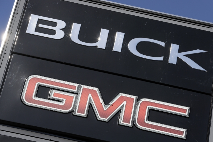 FILE- In this April 25, 2017, file photo, a General Motors dealer's sign stands in Nashville, Tenn. U.S. auto companies such as General Motors, Tesla and Ford faltered this year in Consumer Reports' reliability rankings as readers reported more mechanical trouble and fewer problems with infotainment systems.(AP Photo/Mark Humphrey)