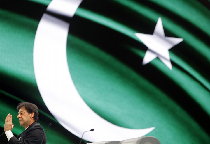 Pakistani Prime Minister Imran Khan, speaks in front of a screen displaying his national flag during the opening of the Future Investment Initiative conference, in Riyadh, Saudi Arabia, Tuesday, Oct. 23, 2018. A high-profile economic forum in Saudi Arabia has begun in Riyadh, the kingdom's first major event on the world stage since the killing of writer Jamal Khashoggi at the Saudi Consulate in Istanbul earlier this month. (AP Photo/Amr Nabil)