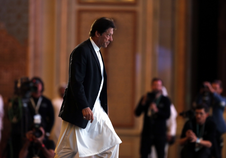 Pakistani Prime Minister Imran Khan prepares to speak at the opening of the Future Investment Initiative conference, in Riyadh, Saudi Arabia, Tuesday, Oct. 23, 2018. The high-profile economic forum in Saudi Arabia is the kingdom's first major event on the world stage since the killing of writer Jamal Khashoggi at the Saudi Consulate in Istanbul earlier this month. (AP Photo/Amr Nabil)
