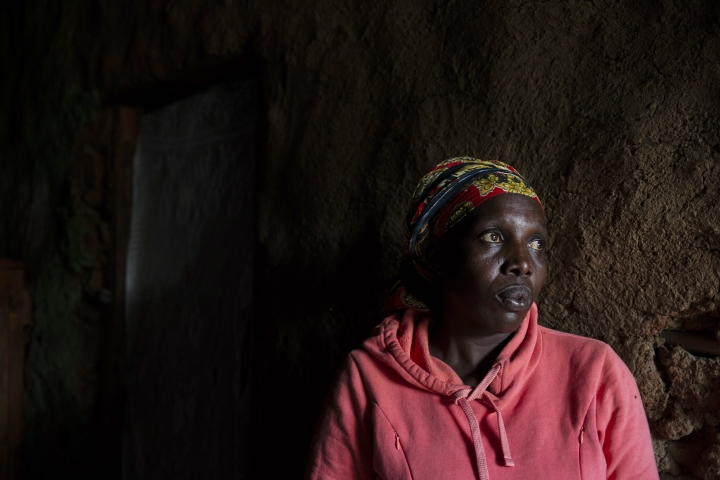 Maimuna Awuor Omuya stands outside her home in Nairobi, Kenya on Aug. 9, 2018. In September 2010, unable to pay her bill at Pumwani Maternity Hospital after the delivery of her sixth child, Omuya and her baby were imprisoned along with more than 60 other women in a damp ward. She often slept on the wet ground next to a flooded toilet. Mother and child were released after nearly a month, but only when one of Omuya's friends appealed to the mayor to intervene. (AP Photo/Bram Janssen)