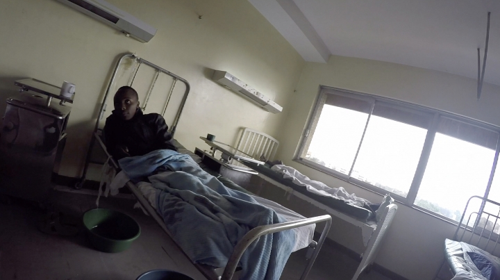 Detained patients lie on beds in the Kenyatta National Hospital in Nairobi, Kenya on Monday, Aug. 6, 2018. At east Africa's biggest medical institution, and at an astonishing number of other hospitals around the world, if you don't pay up, you don't go home. (AP Photo/Desmond Tiro)