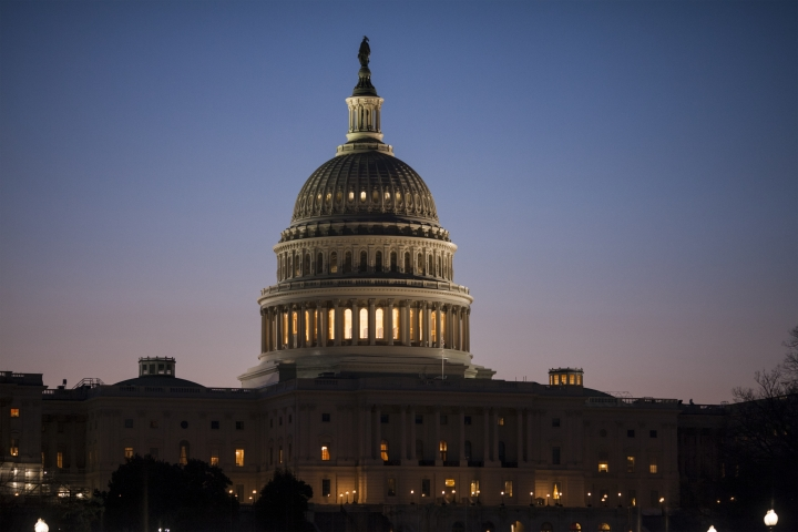 FILE - In this March 17, 2017, file photo, the Capitol is seen at dawn in Washington. An overwhelming majority of Americans see the United States as greatly divided on important issues, and few say they believe that will get better any time soon, according to an October poll by The Associated Press-NORC Center for Public Affairs Research. (AP Photo/J. Scott Applewhite, File)