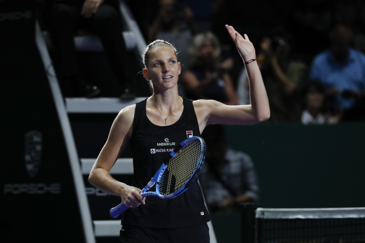 Karolina Pliskova of the Czech Republic celebrates after competing against Petra Kvitova of the Czech Republic during their women's singles match at the WTA tennis finals in Singapore, Thursday, Oct. 25, 2018. (AP Photo/Vincent Thian)