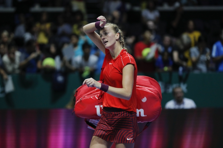 Petra Kvitova of the Czech Republic leaves the court after competing against Karolina Pliskova of the Czech Republic during their women's singles match at the WTA tennis finals in Singapore, Thursday, Oct. 25, 2018. (AP Photo/Vincent Thian)