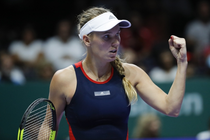 Caroline Wozniacki of Denmark celebrates a point win over Elina Svitolina of the Ukraine during their women's singles match at the WTA tennis finals in Singapore, Thursday, Oct. 25, 2018. (AP Photo/Vincent Thian)