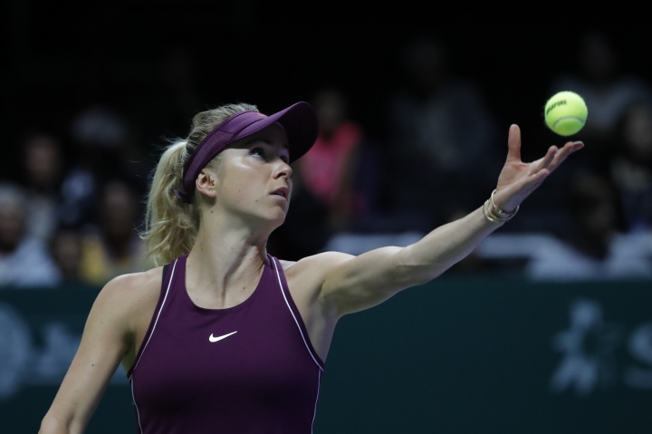 Elina Svitolina of the Ukraine serves while competing against Caroline Wozniacki of Denmark during their women's singles match at the WTA tennis finals in Singapore, Thursday, Oct. 25, 2018. (AP Photo/Vincent Thian)
