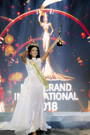 In this Oct. 25, 2018, photo released by Miss Grand International Co., Ltd., new Miss Grand International Paraguay's Clara Sosa holds trophy after winning Miss Grand International 2018 in Yangon, Myanmar. (Miss Grand International Co., Ltd via AP)