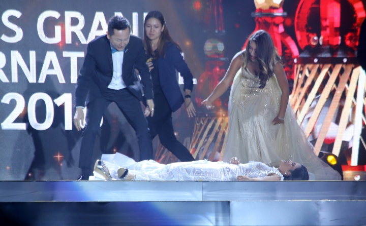 In this Oct. 25, 2018 photo, Miss Paraguay Clara Sosa lies on stage after she fainted following the announcement that she won as Miss Grand International 2018 during the pageant's coronation night held in Yangon, Myanmar. (AP Photo)