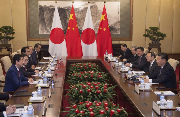 Japanese Prime Minister Shinzo Abe, left, talks with Chinese President Xi Jinping, right, during a meeting at the Diaoyutai State Guesthouse in Beijing Friday, Oct. 26, 2018. (Nicolas Asfouri/Pool photo via AP)