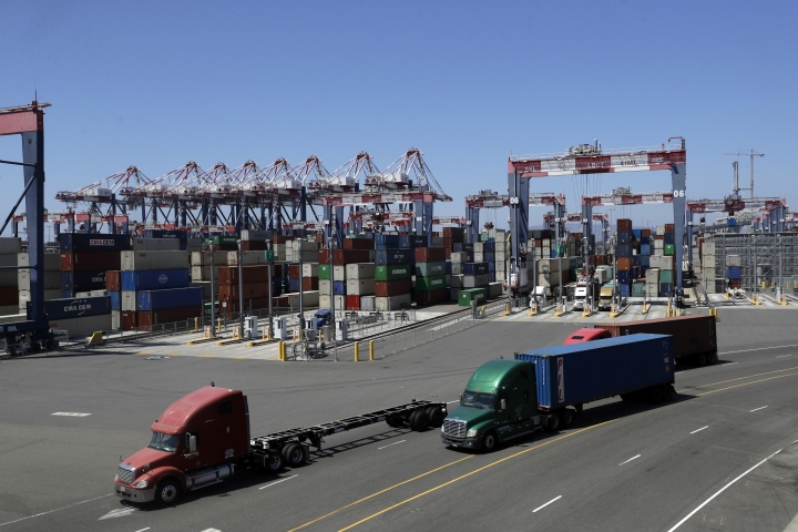 FILE- In this Aug. 22, 2018, file photo trucks travel along a loading dock at the Port of Long Beach in Long Beach, Calif. On Friday, Oct. 26, the Commerce Department issues the first of three estimates of how the U.S. economy performed in the third quarter. (AP Photo/Marcio Jose Sanchez, File)
