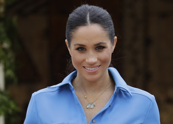 Britain's Meghan, Duchess of Sussex smiles during a visit to Tupou College in Tonga, Friday, Oct. 26, 2018. Prince Harry and his wife Meghan are on day eleven of their 16-day tour of Australia and the South Pacific.(AP Photo/Kirsty Wigglesworth, pool)