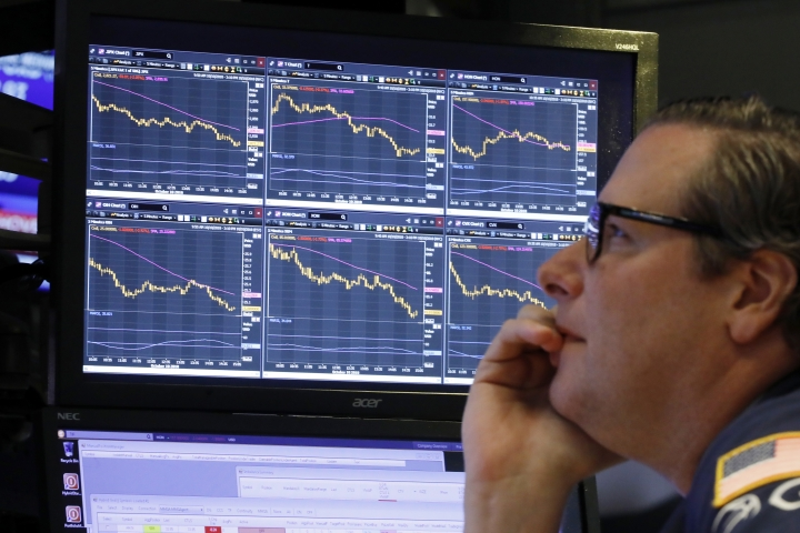 """FILE- In this Oct. 10, 2018, file photo specialist Gregg Maloney works at his post on the floor of the New York Stock Exchange. So far this month, high-growth stocks in the Russell 3000 index have plummeted 11.3 percent, versus 7.5 percent for their lower-priced counterparts known as """"value"""" stocks, as of Wednesday. It's the biggest such monthly gap in performance in a decade. (AP Photo/Richard Drew, File)"""