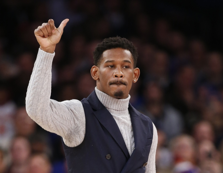 FILE - In this Jan. 9, 2017, file photo, WBA middleweight boxing champion Danny Jacobs acknowledges the crowd during a timeout in the first half of an NBA basketball game between the New York Knicks and the New Orleans Pelicans, at Madison Square Garden in New York. Jacobs meets Sergiy Derevyanchenko, Saturday night, Oct. 27, 2018, inside the Theater at Madison Square Garden, with the winner taking the IBF's vacant version of the 160-pound title. (AP Photo/Kathy Willens, File)
