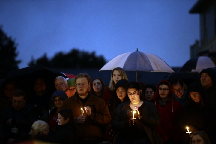 People hold candles as they gather for a vigil in the aftermath of a deadly shooting at the Tree of Life Congregation, in the Squirrel Hill neighborhood of Pittsburgh, Saturday, Oct. 27, 2018. (AP Photo/Matt Rourke)